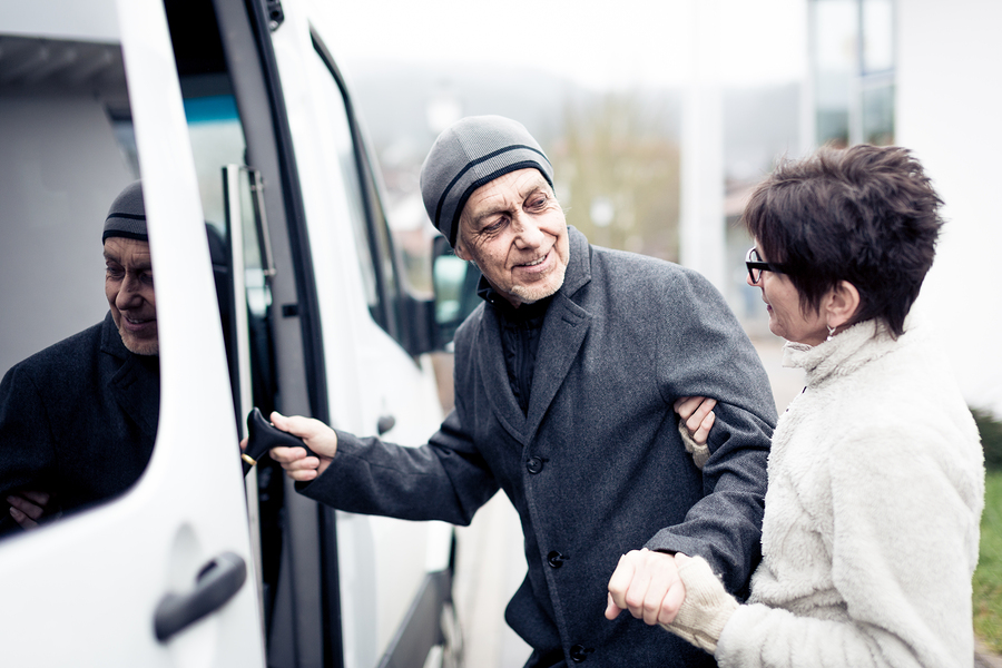 Nurse helping senior man enter a van in Laguna Hills, California
