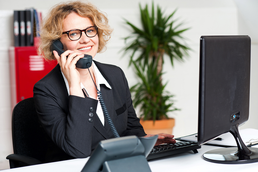Woman answering phone calls at Easy Living Home Care Services in Laguna Hills, California.