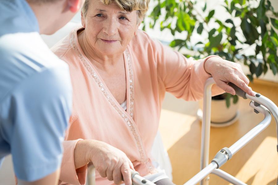 Nurse assisting senior woman with walker in Laguna Hills, California