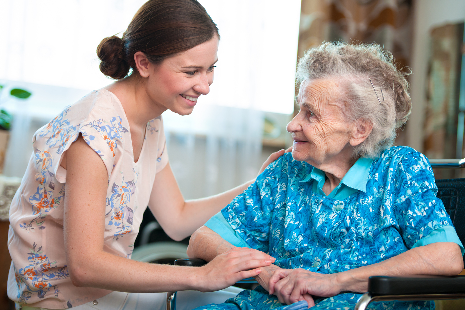 Senior woman with her caregiver at home in Irvine, CA