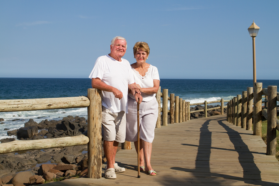 Happy senior couple at the beach in Huntington Beach, CA