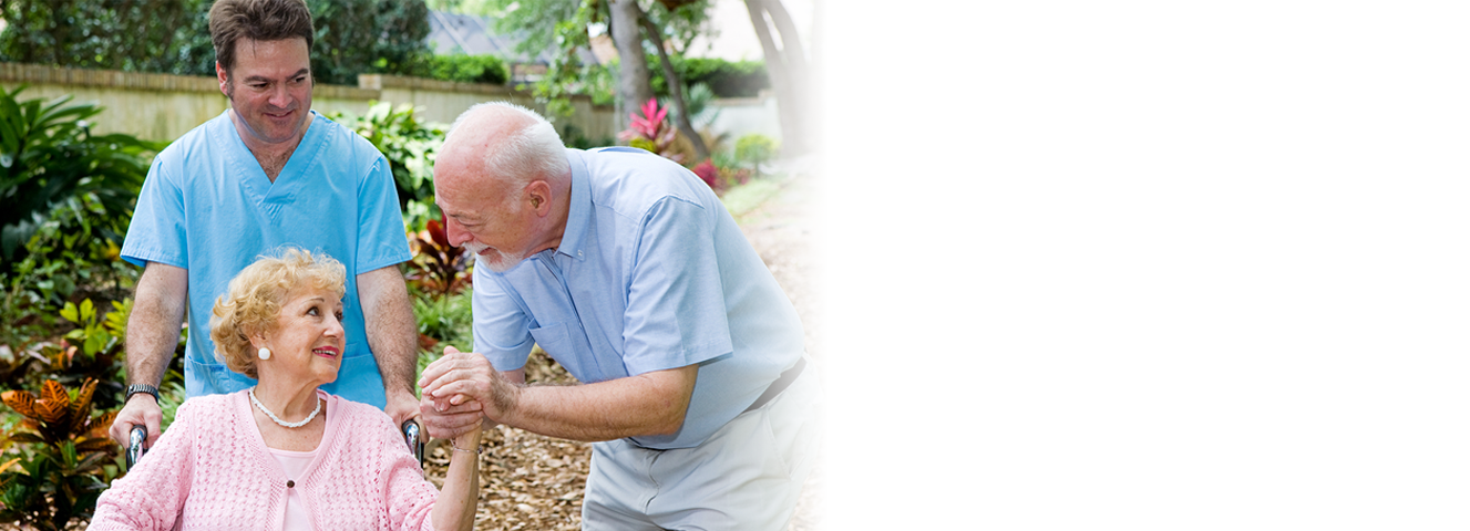 Caregiver helps woman through garden in Laguna Hills, CA.