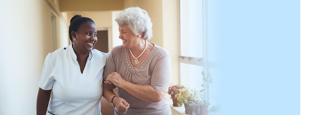 Caregiver and Senior women walking in Laguna Hills, CA